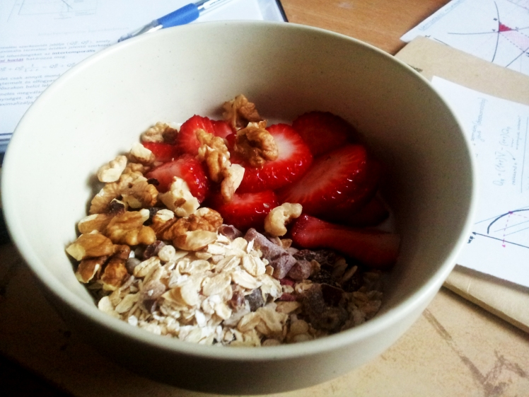 And eat healthy snacks! This is a bowl of plain yoghurt topped with strawberries, walnuts and granola!